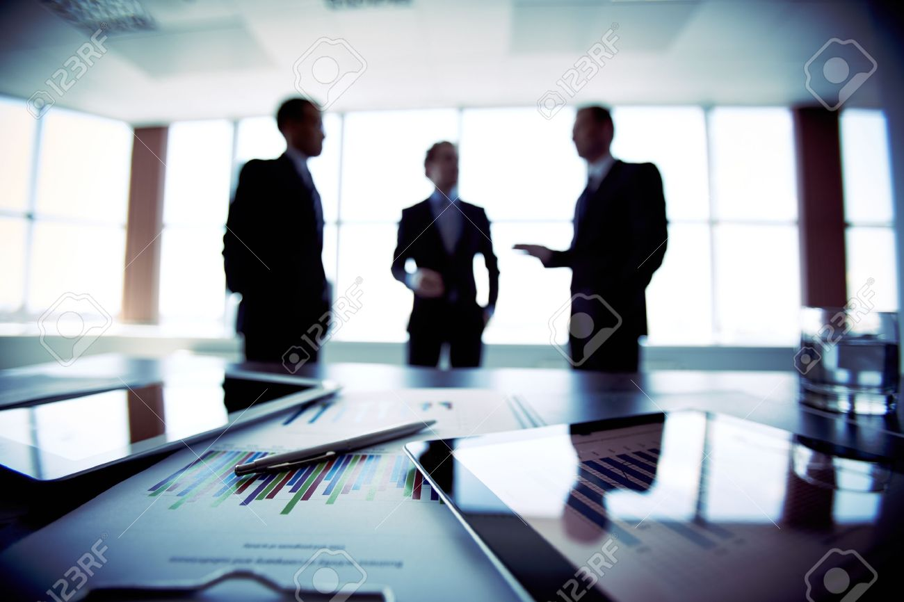 Colleagues meeting to discuss their future financial plans, only silhouettes being viewed - 20818657