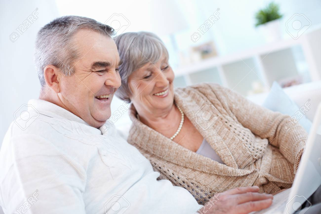 Portrait of mature man and his wife working with laptop at home Stock Photo - 22247108