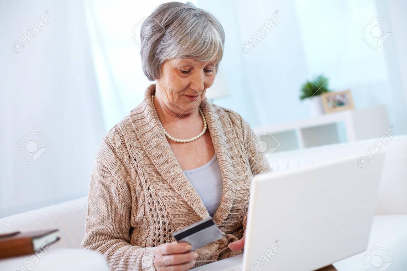 Portrait of modern aged female shopping through internet Stock Photo - 23244516