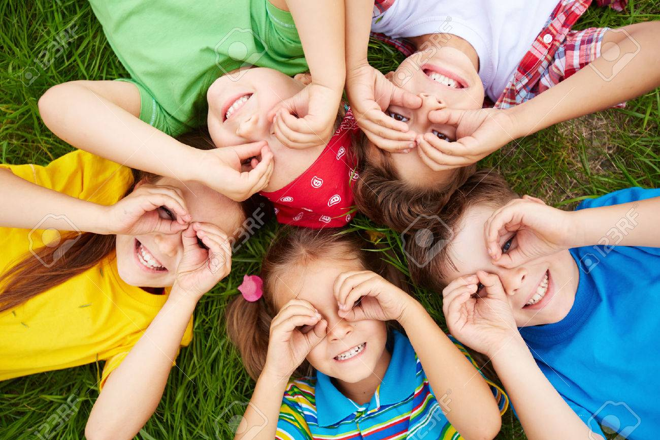 Group of cute children lying on grass - 31184141