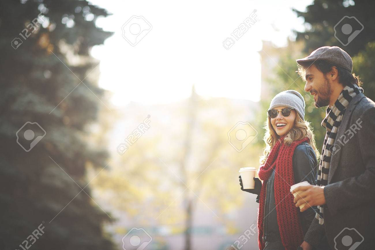 Young people walking in autumn Stock Photo - 32866389