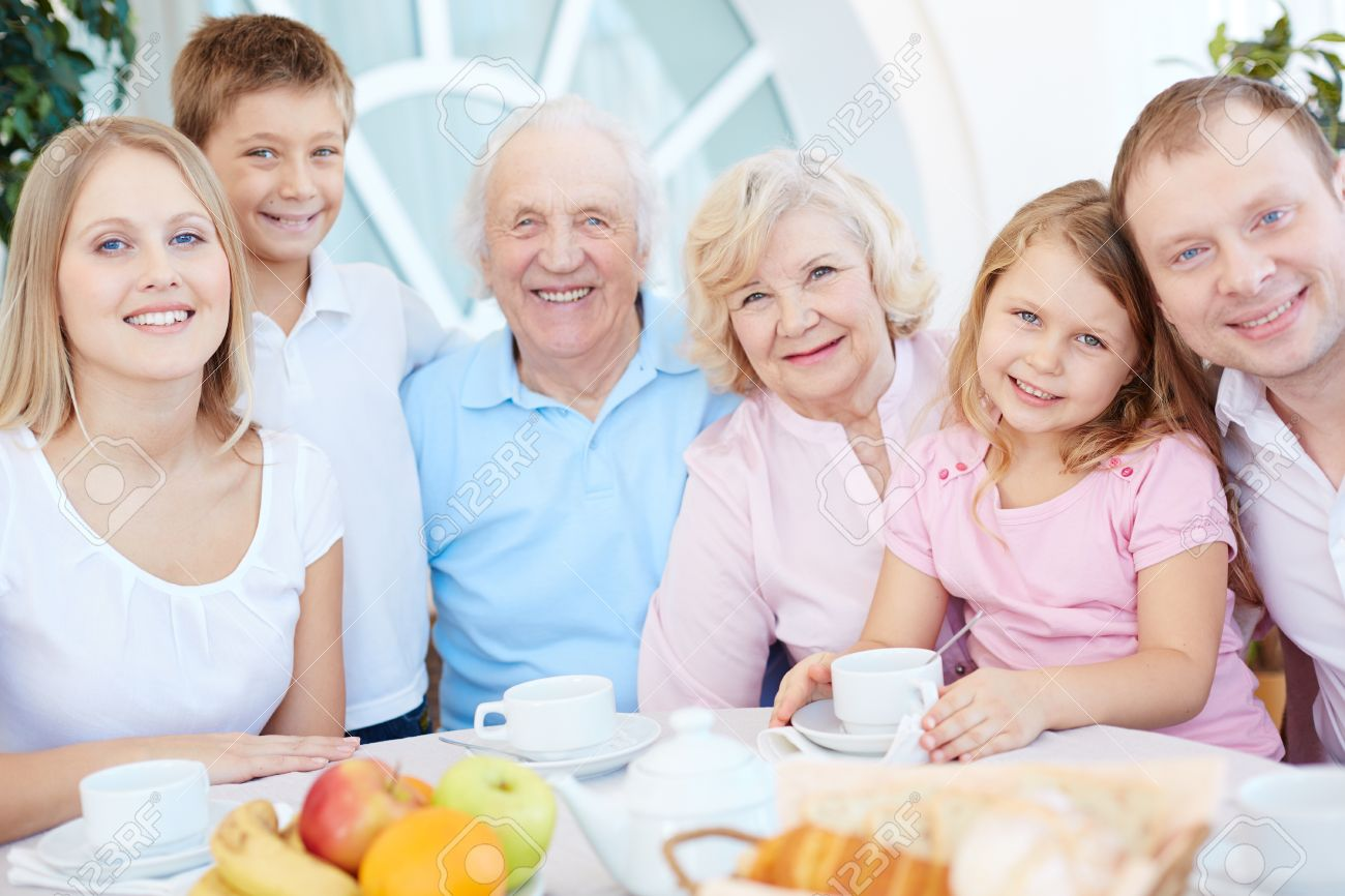 Big Happy Family Gathered By Dinner Table Stock Photo   37247972