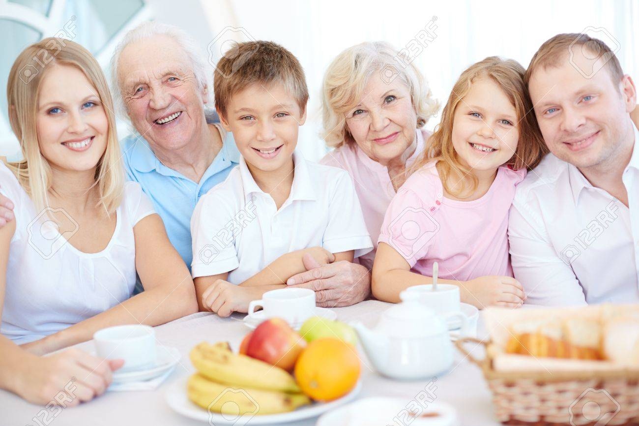 Big Happy Family Looking At Camera By Dinner Table Stock Photo   37247974