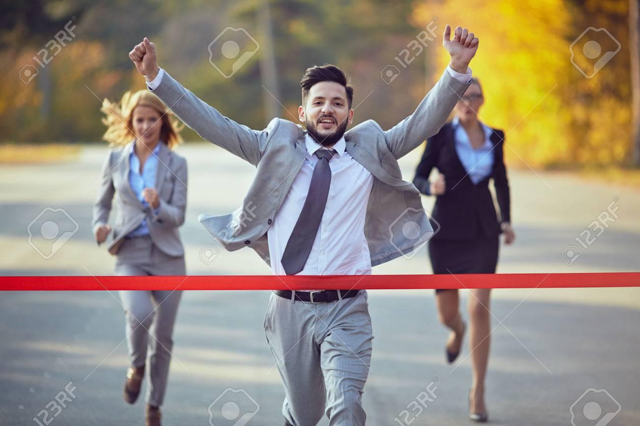 Businessman reaching finish line - 37750677