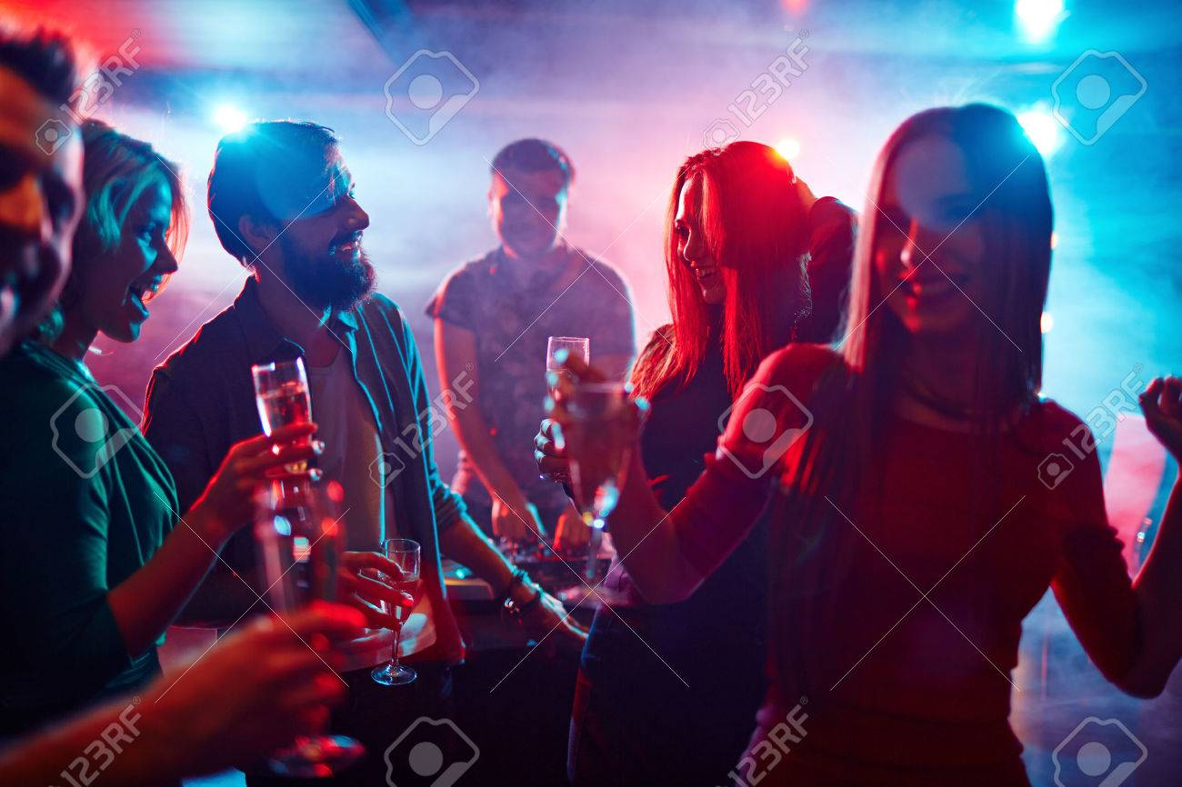 Happy Friends Toasting At Night Party Stock Photo, Picture And Royalty Free  Image. Image 38887738.
