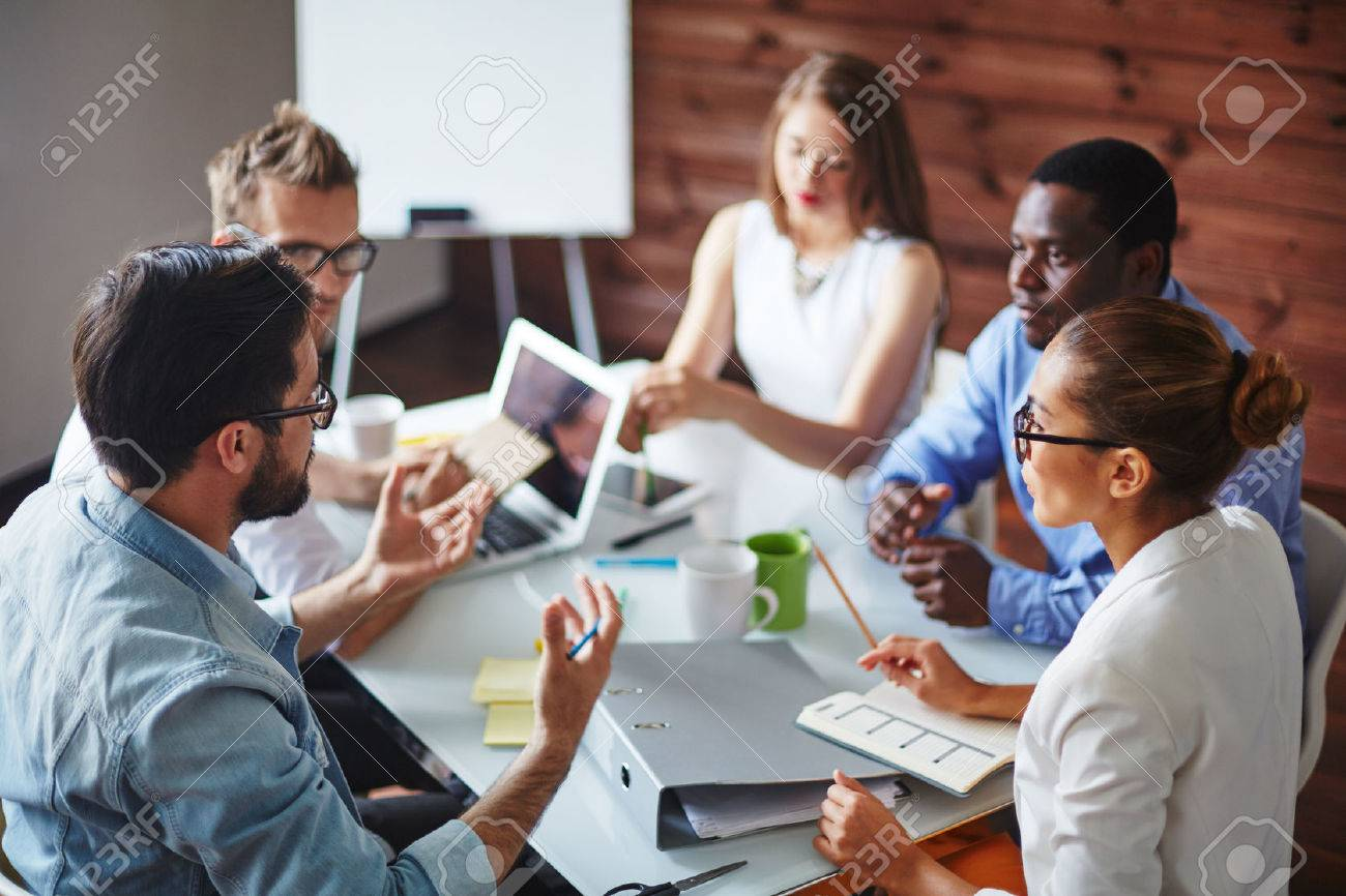 Group of multi-ethnic business partners discussing ideas Stock Photo - 42923695