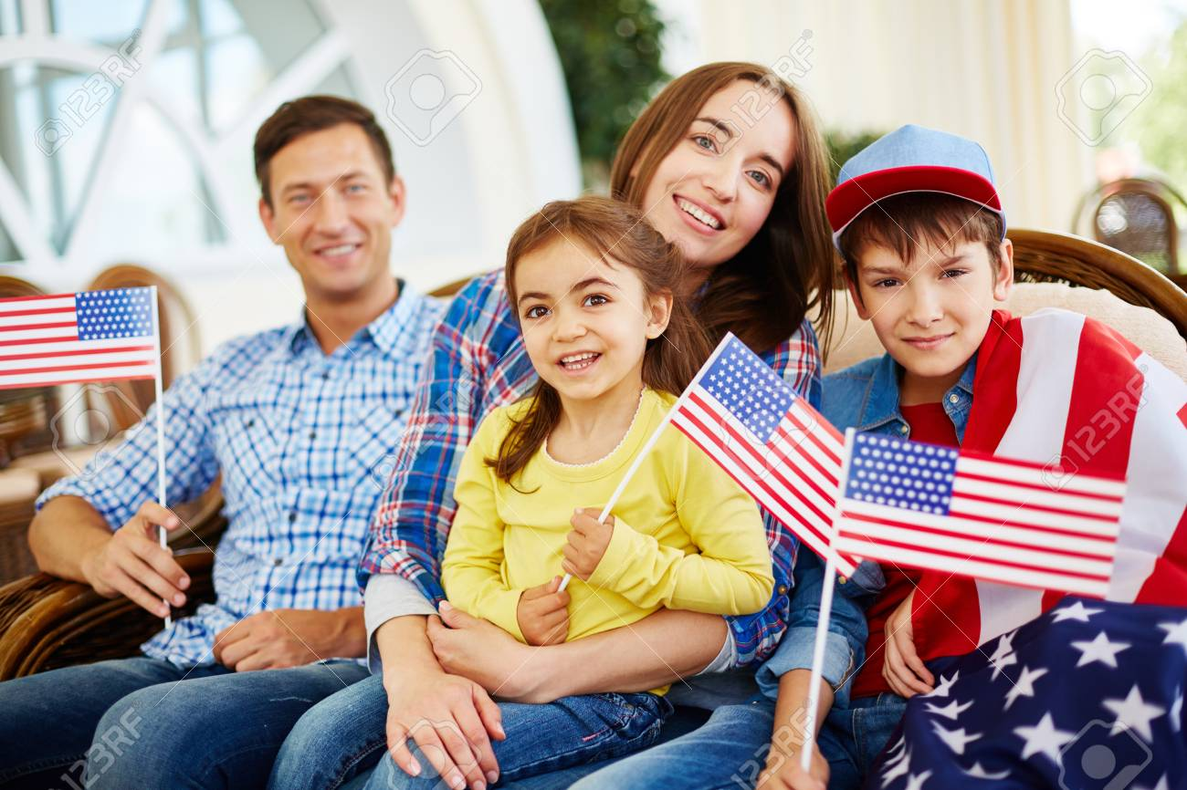 Family of patriots with usa flags on independence day stock photo 43164524