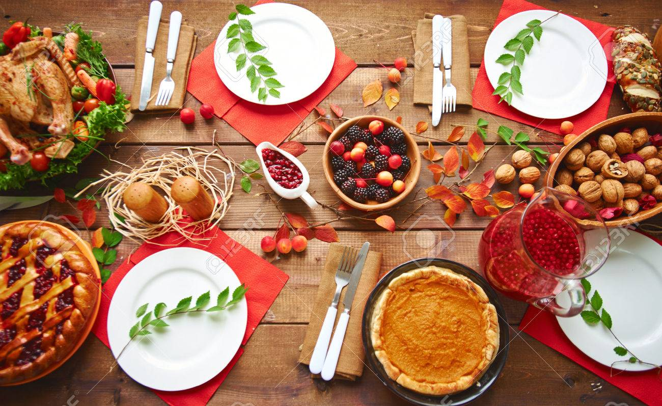 High angle view of table served for thanksgiving dinner with family Stock Photo - 44085298