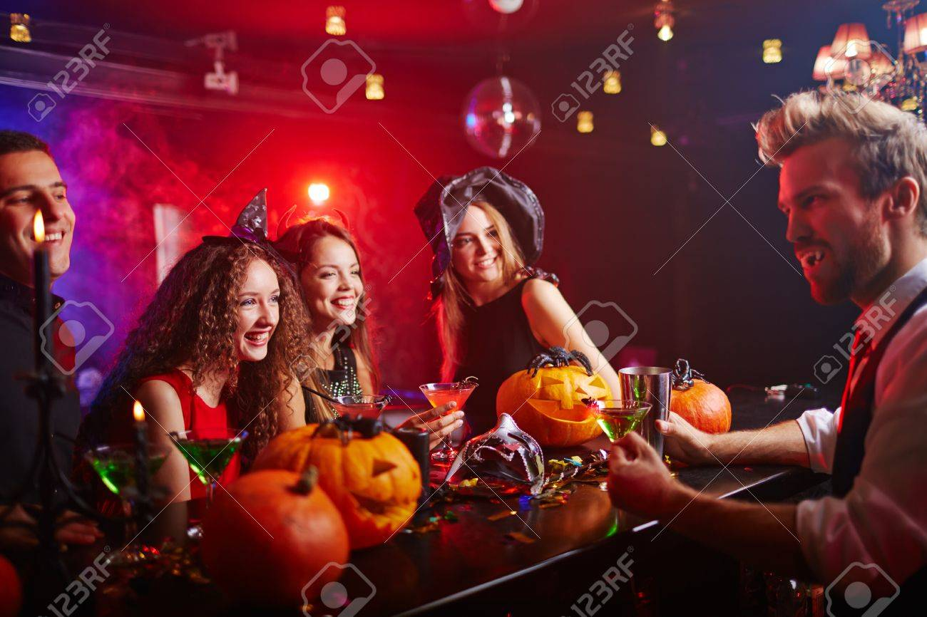 disguised vampire serving drinks to witches at halloween night stock photo 44207200 - Halloween Night Party