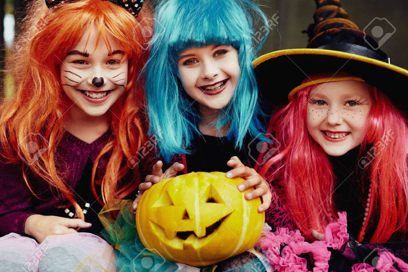 Group Of Girls In Halloween Costumes Looking At Camera With Smiles Stock  Photo   44897772