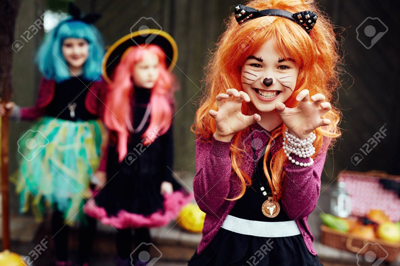 Halloween Costumes For Two Friends.Frightening Girl In Halloween Costume Looking At Camera With
