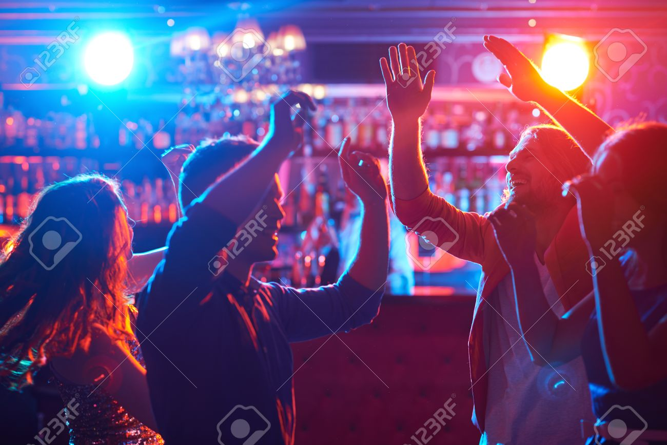 Happy friends dancing at party in bar Stock Photo - 45607194