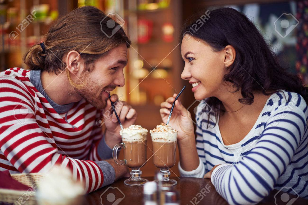 Happy young dates having latte during rest in cafe Stock Photo - 45607430