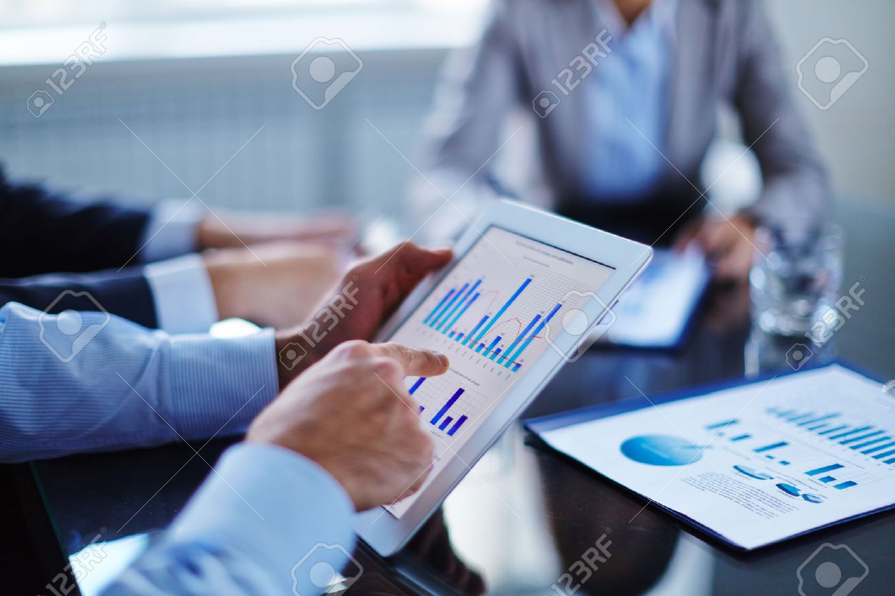 Businessman pointing at touchscreen with chart Stock Photo - 47055779