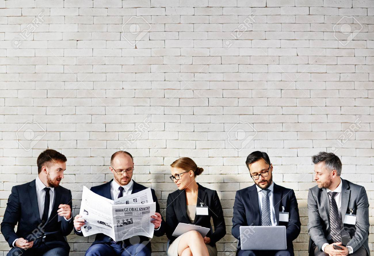 Business people sitting in a row and working at office Stock Photo - 47783187