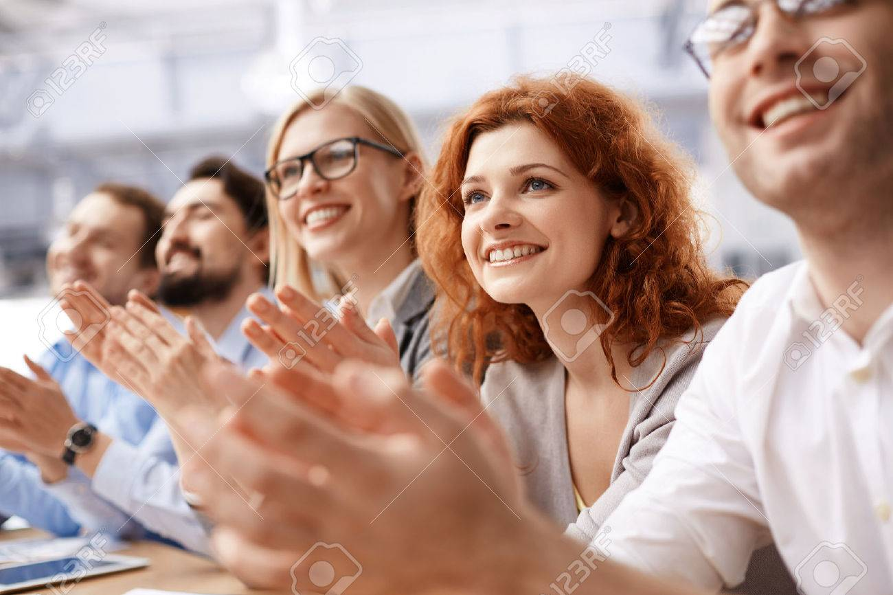 Happy business team applauding at conference Stock Photo - 49878265