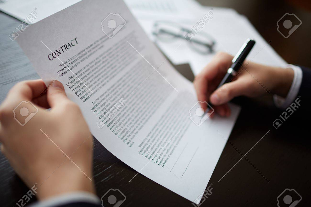 Close-up of male hands signing a contract with pen Stock Photo - 50498839