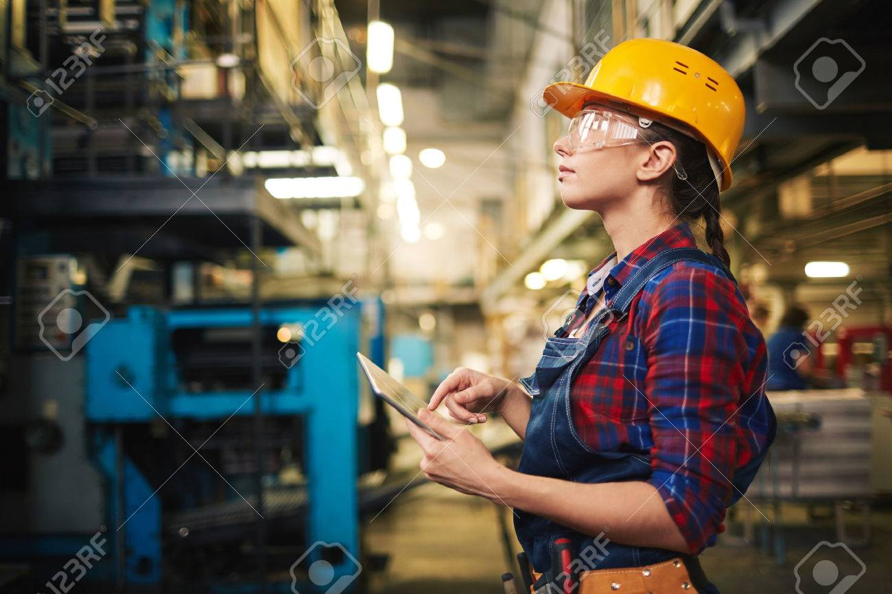 Industrial female inspector worker with touchpad in factory Stock Photo - 50498891