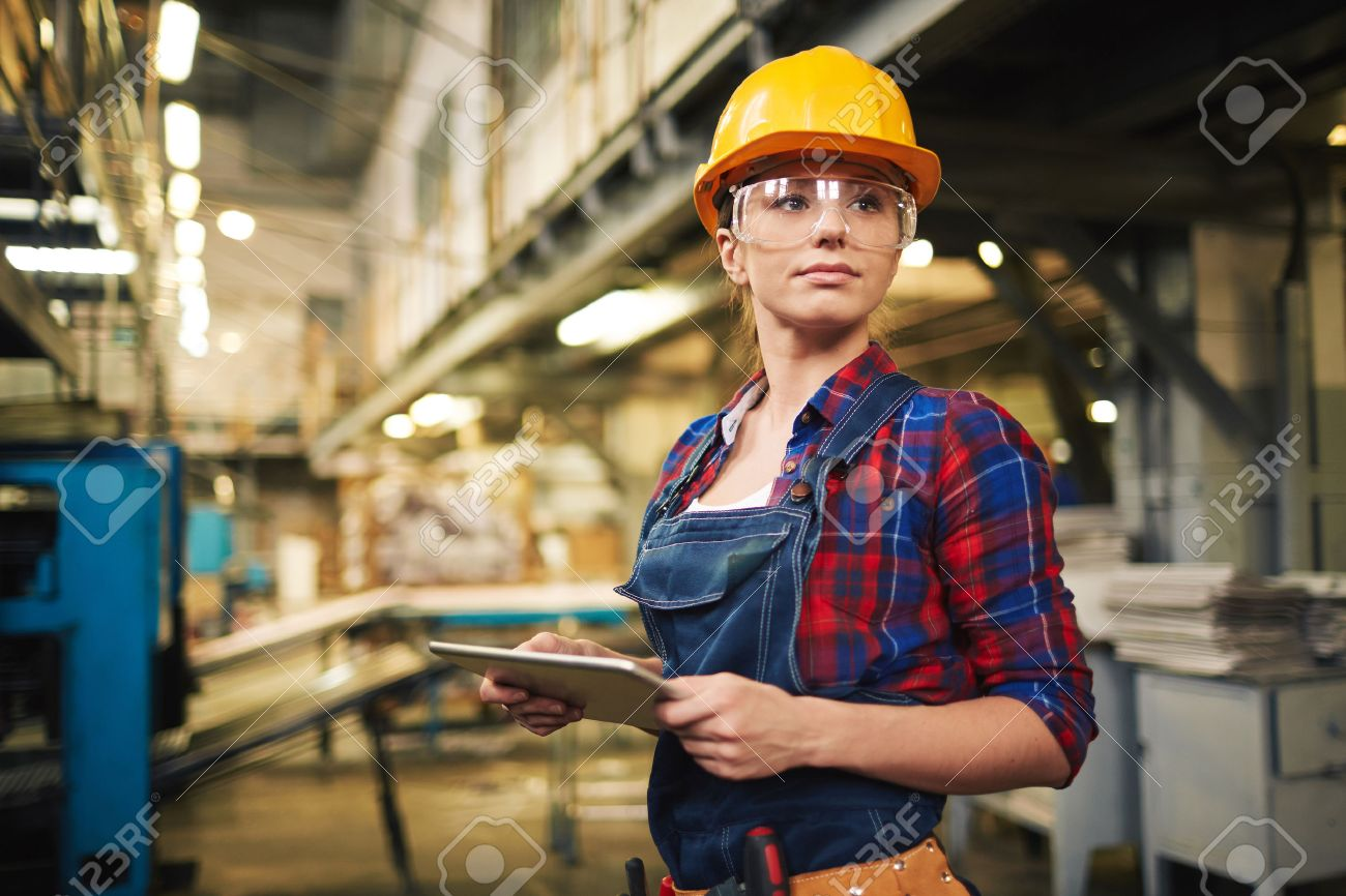 Young factory worker controlling the work Stock Photo - 50498892