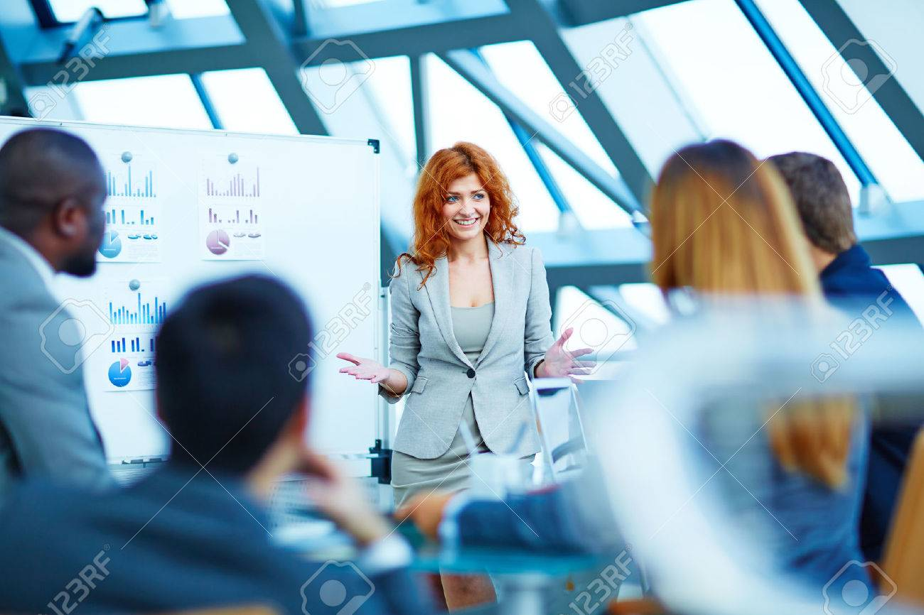 Business people having board meeting in modern office - 50673373