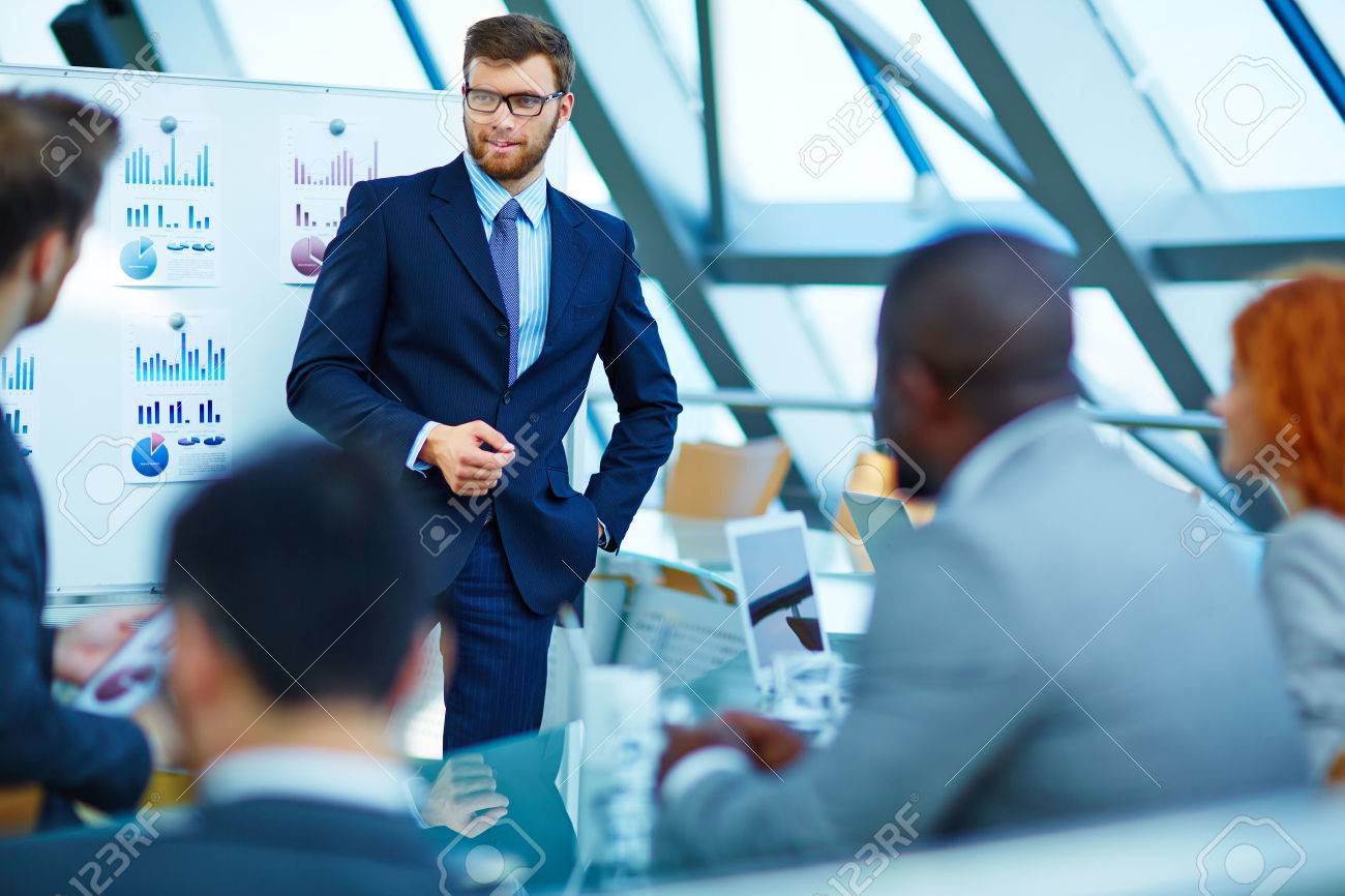 Young businessman making presentation to his colleagues Stock Photo - 50673376
