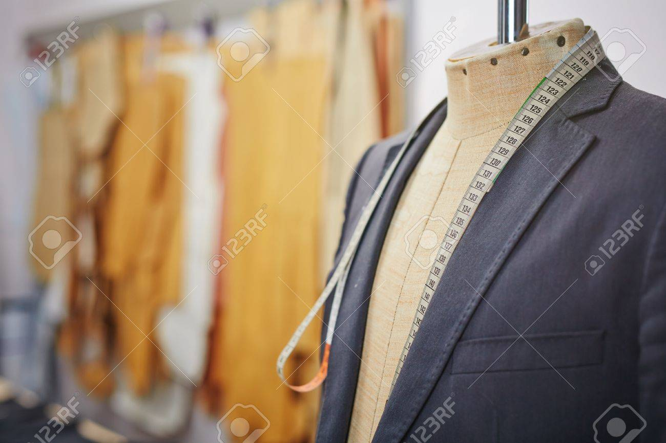New jacket on mannequin and measuring tape - 50877489