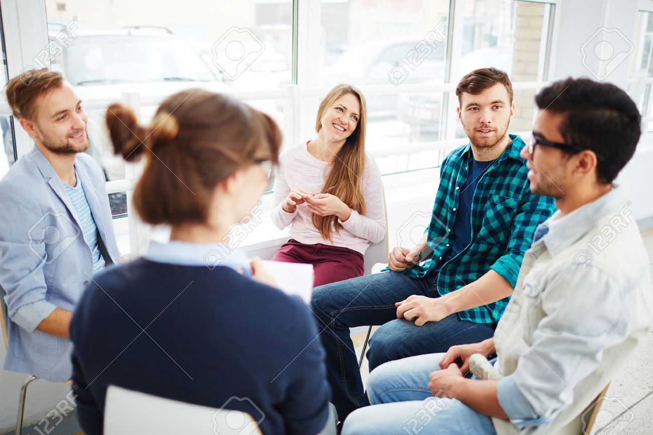 Group of young people communicating at psychological course - 51067190