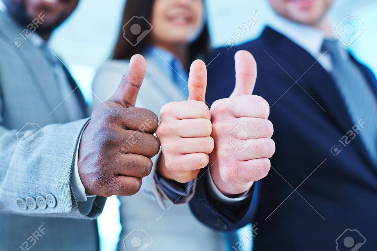 Thumb up gesture shown by three business partners Stock Photo - 51598277
