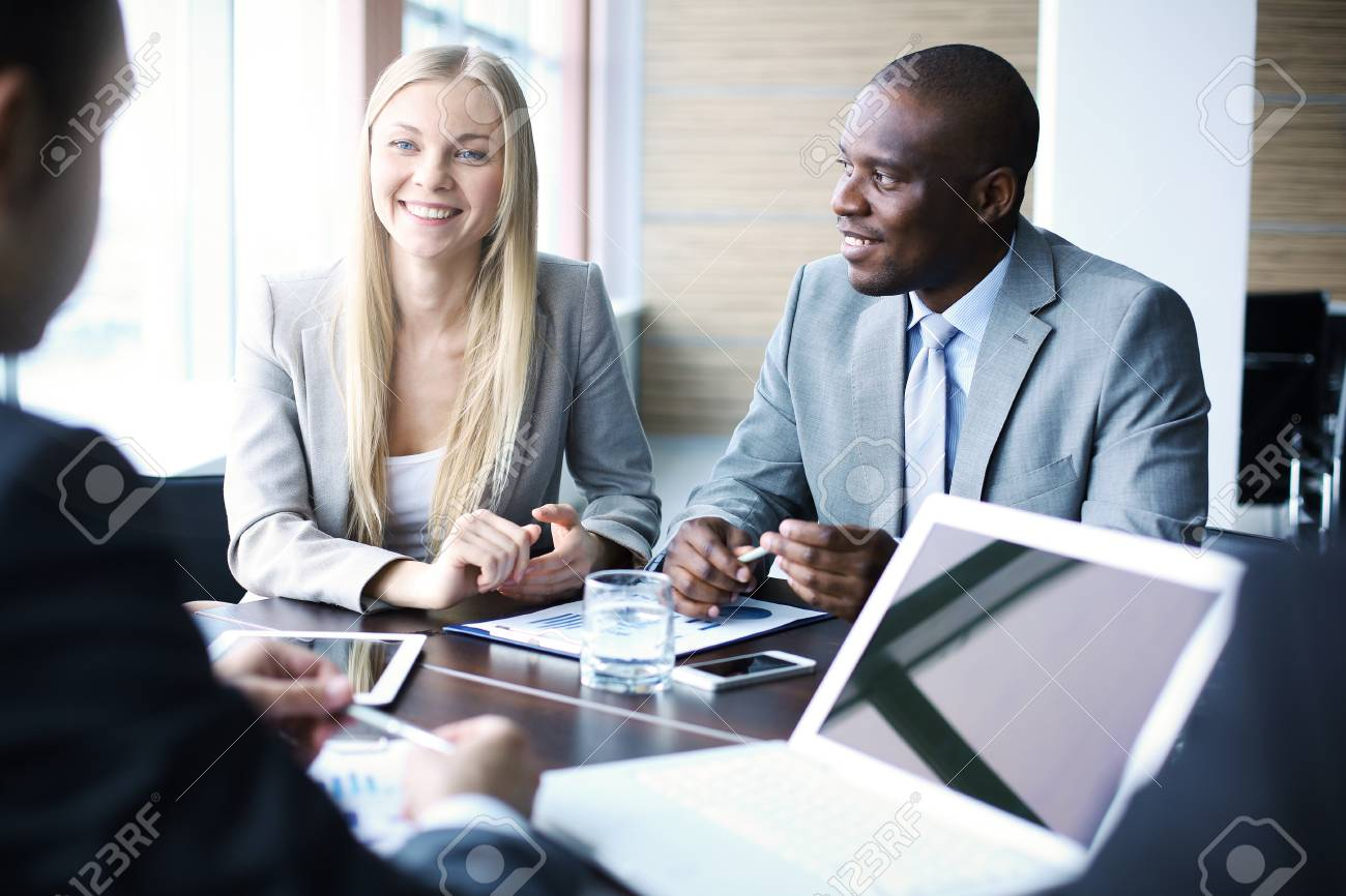 Business team discussing plans together in a meeting - 52936109