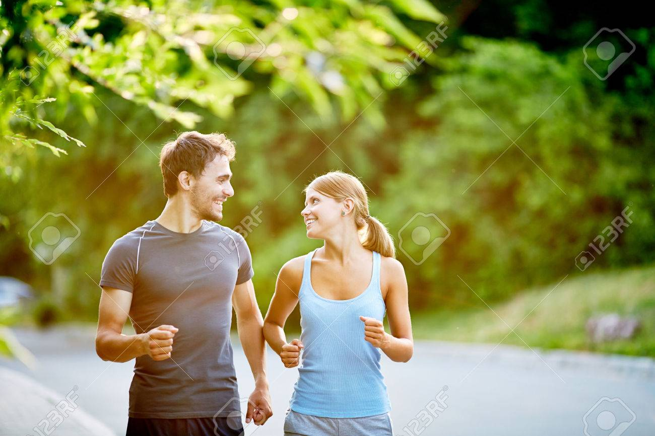 Young couple running together in summer day Stock Photo - 54274498