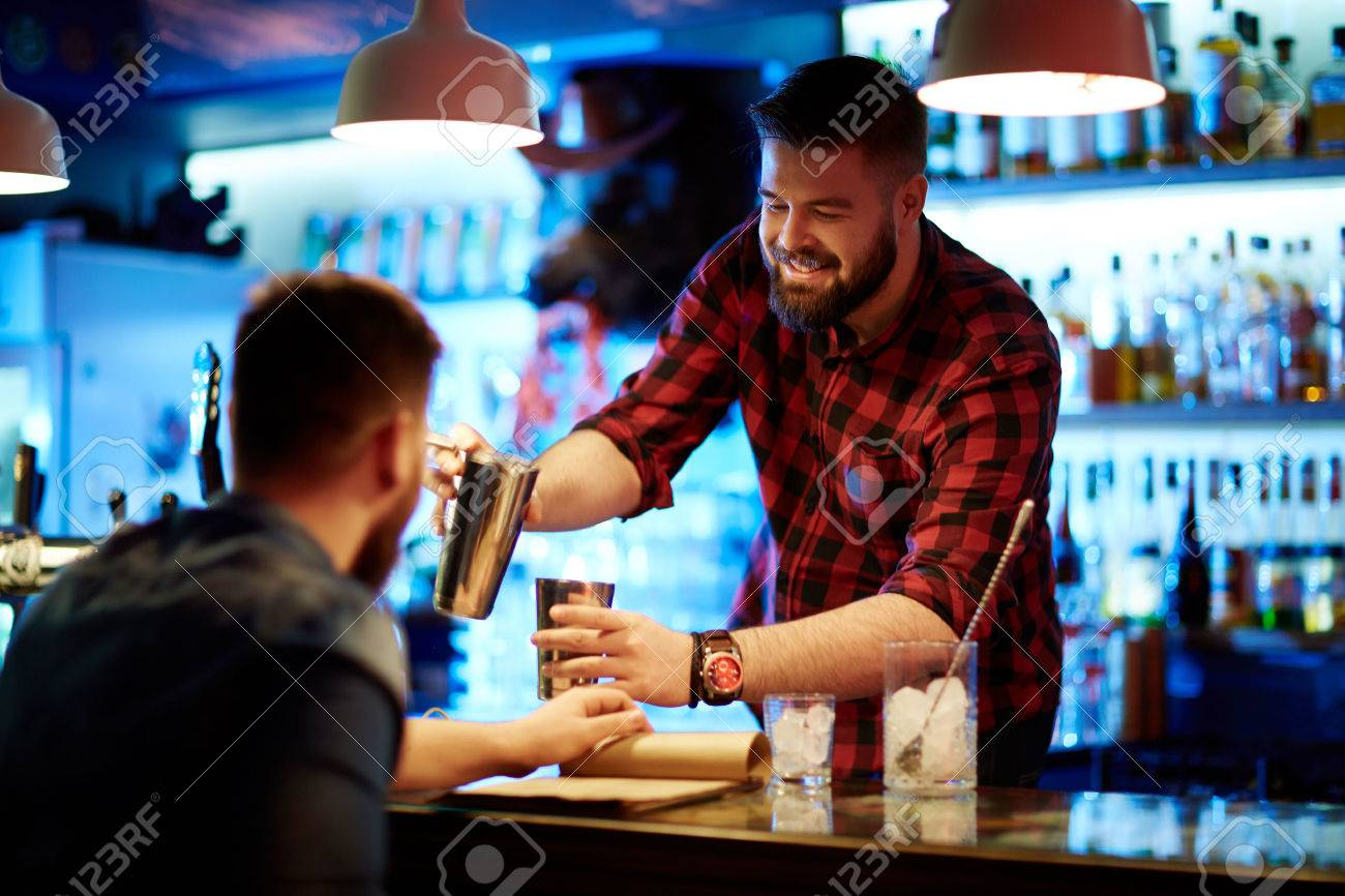 Happy barman making drink for client Stock Photo - 54721164