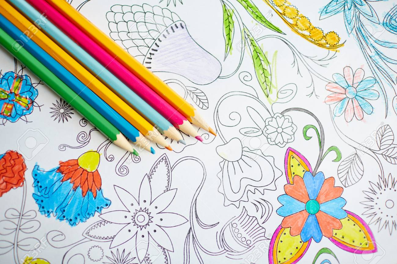 Multi-color Crayons On Open Page Of Coloring Book Stock Photo ...