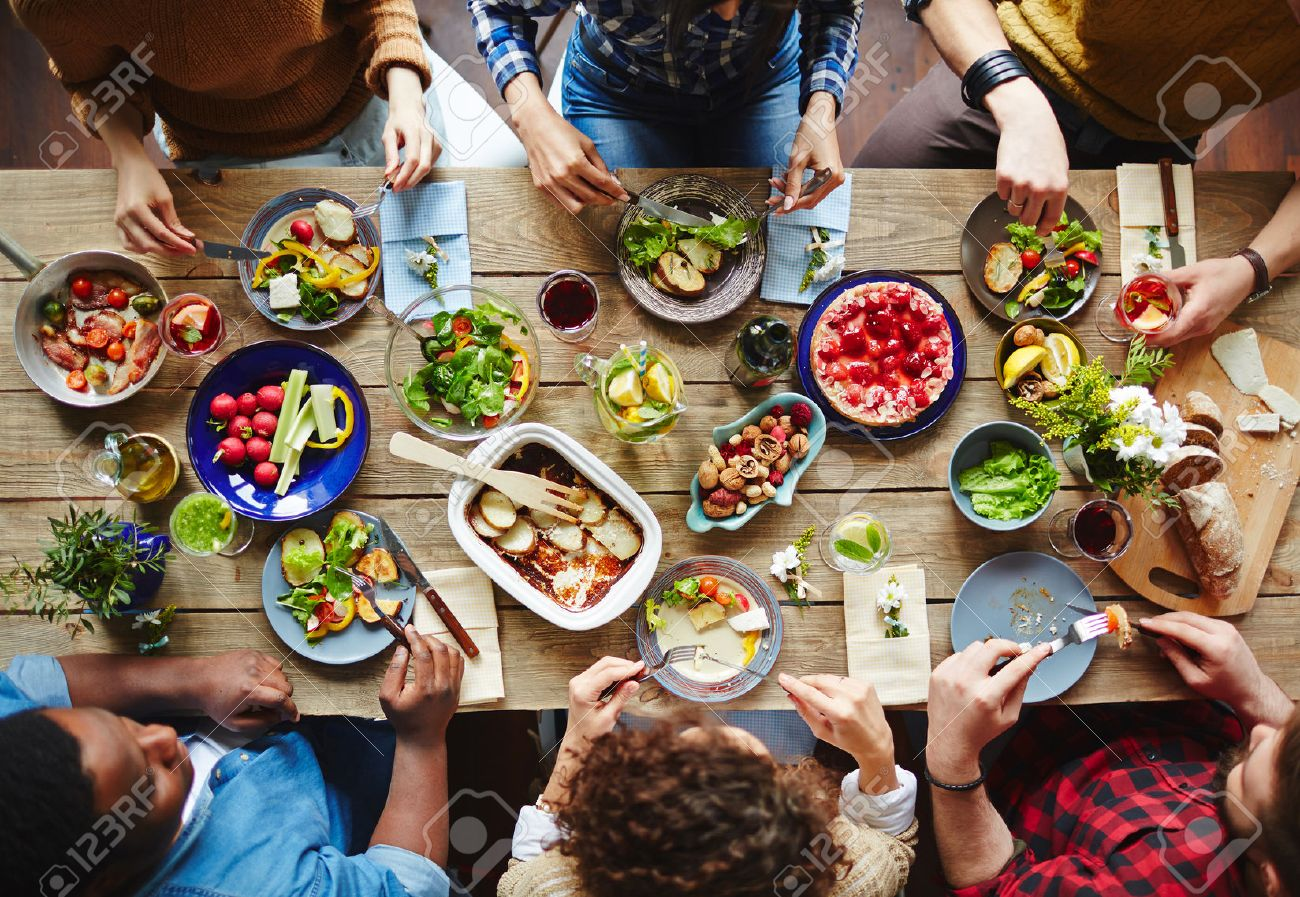 Group of young people eating dinner Stock Photo - 54993876