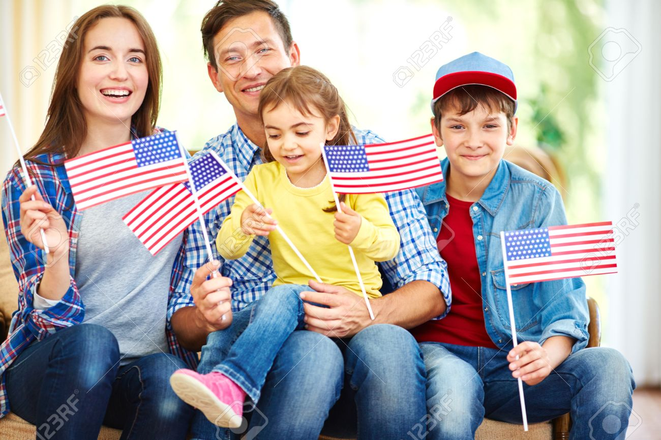 Happy family with flags of usa celebrating independence day stock photo 54993917