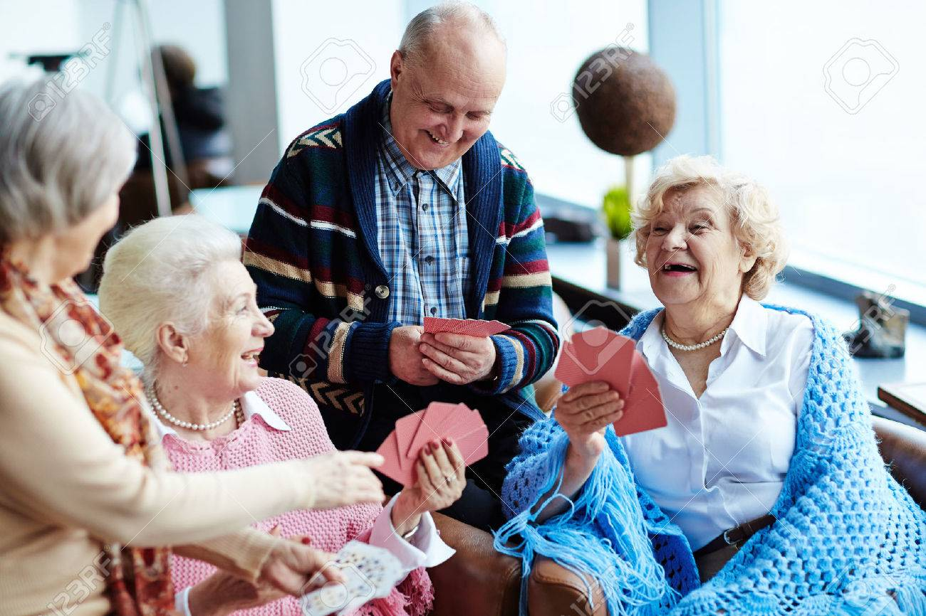 Group of positive seniors playing cards Stock Photo - 56140188