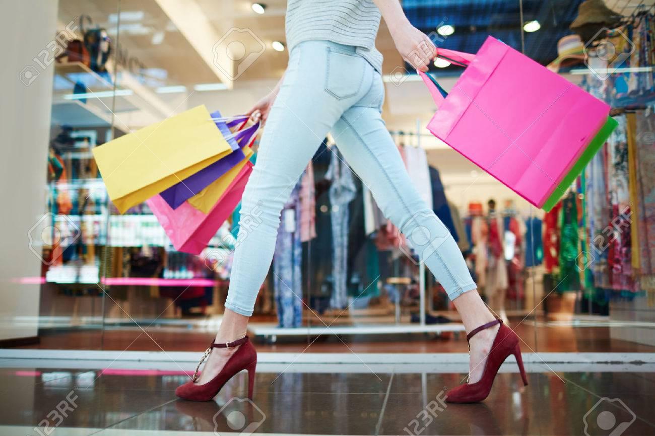 Woman passing through a boutique - 57363353