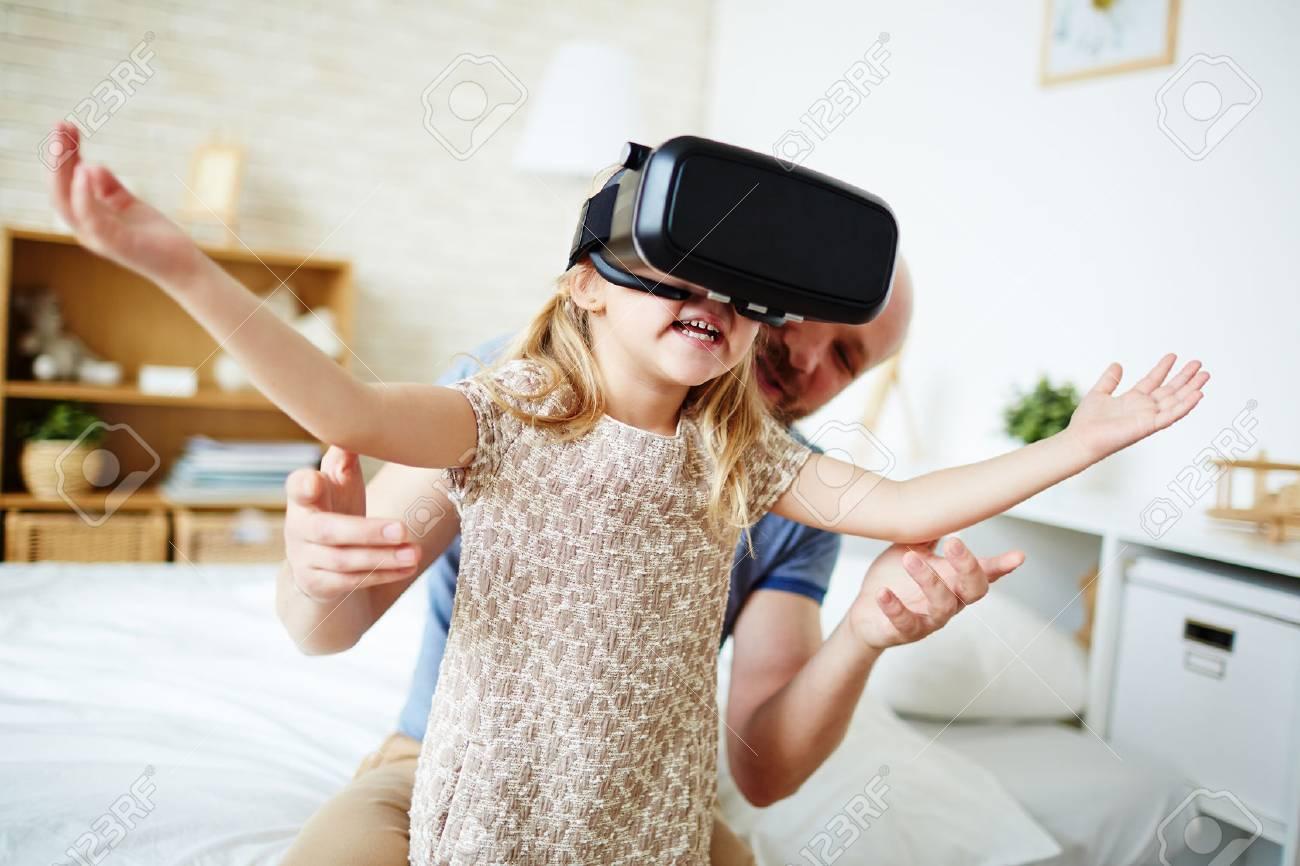 Cute child enjoying virtual reality Stock Photo - 57753032