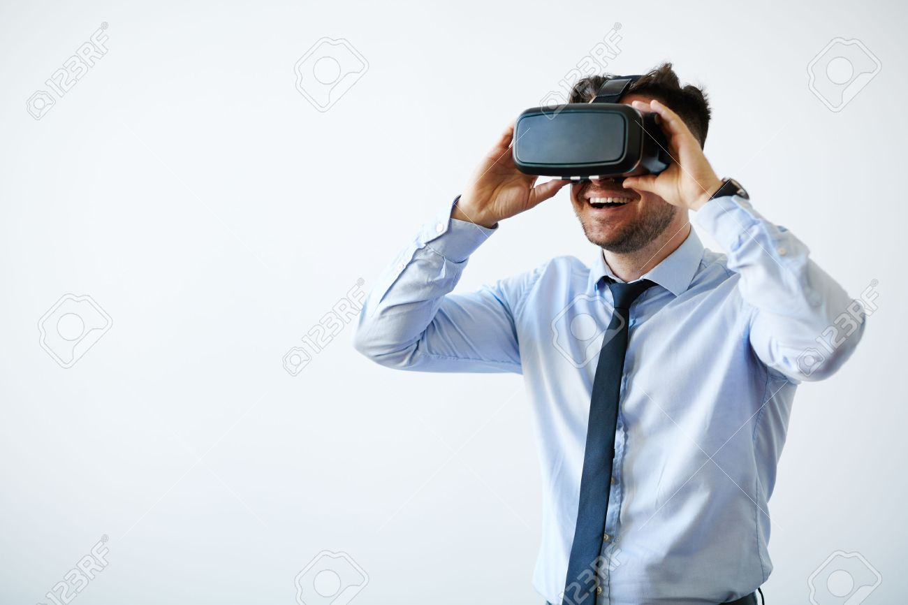 Portrait of excited businessman in vr goggles Stock Photo - 58989462