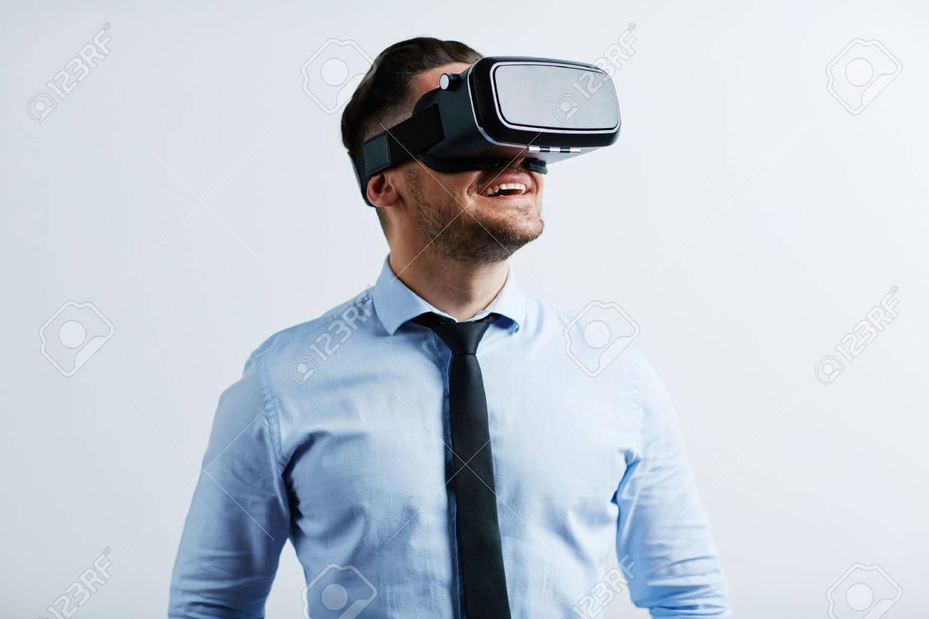 Young businessman trying vr goggles Standard-Bild - 58989463