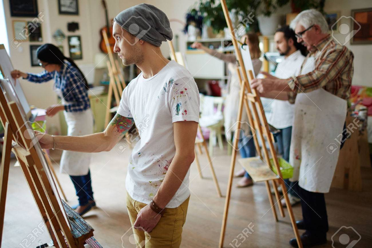 Group of students painting at art lessons Stock Photo - 60798985