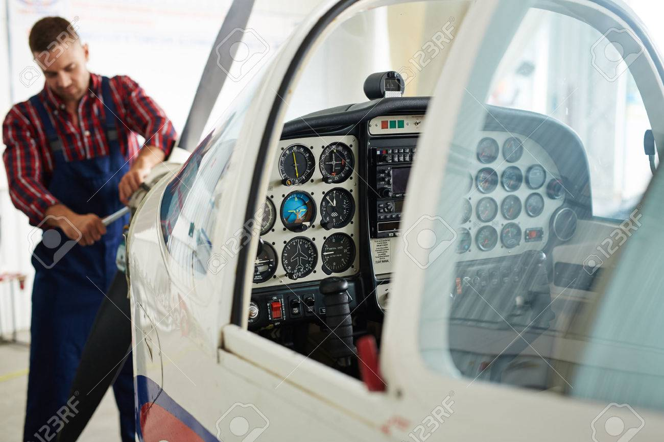 Open cabin of jet in repair service Standard-Bild - 60799022