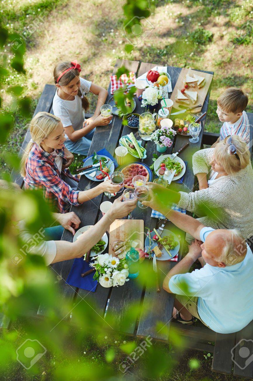 Big happy family with kids and grandparents having healthy tasty bbq lunch outdoors - 61255002