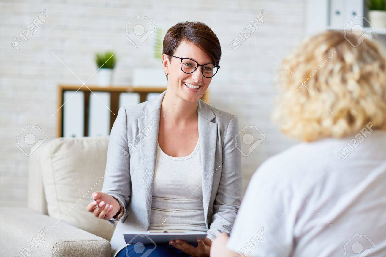 Successful psychologist talking to her patient Standard-Bild - 65108776