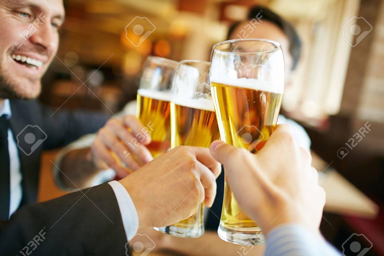 Businessmen drinking beer after successful deal Standard-Bild - 63746531