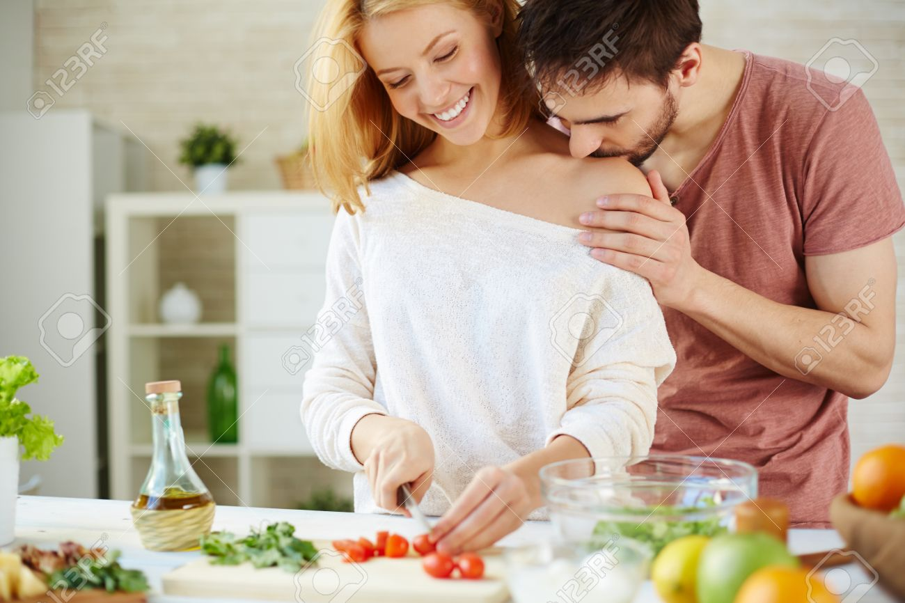 Romantic Couple Cooking Salad In The Kitchen Stock Photo, Picture ...