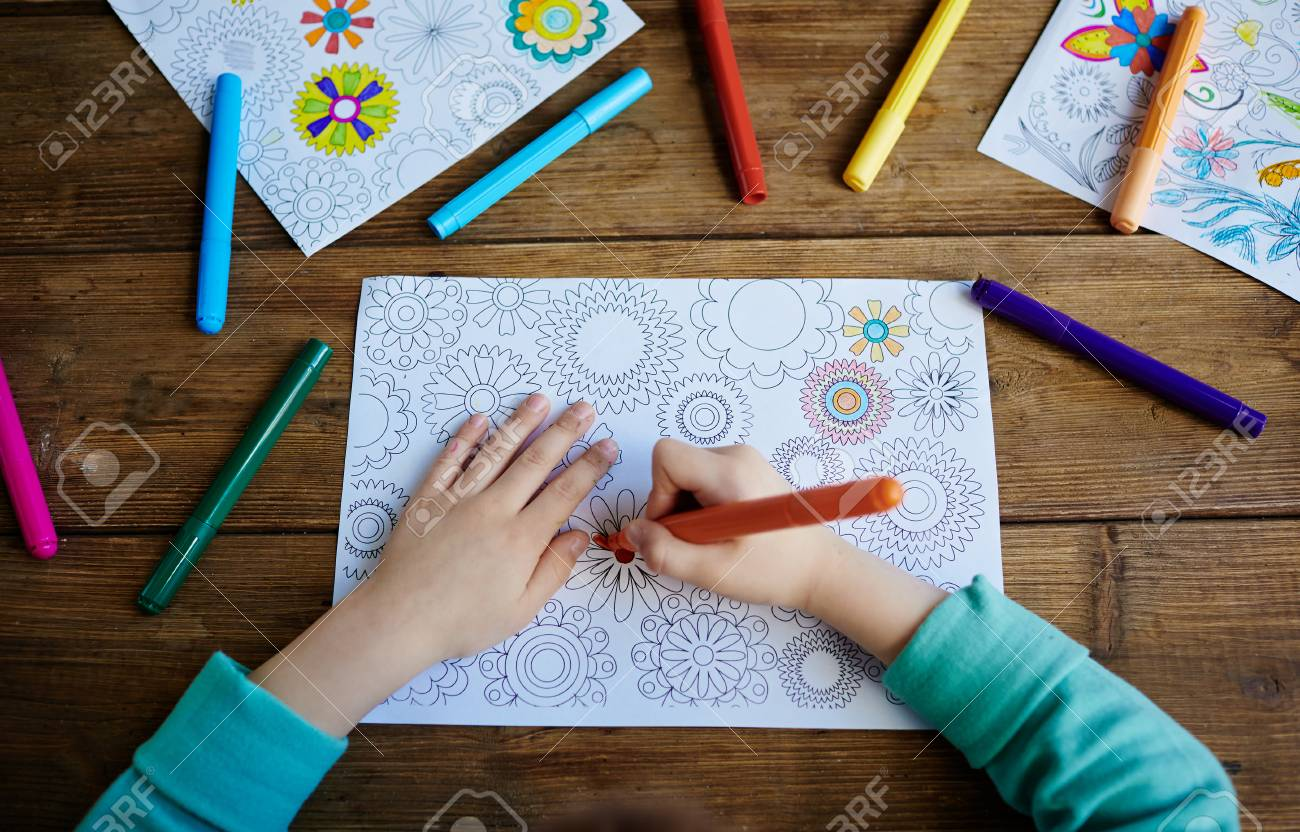 Hands Of Boy Coloring Pics With Crayons Stock Photo