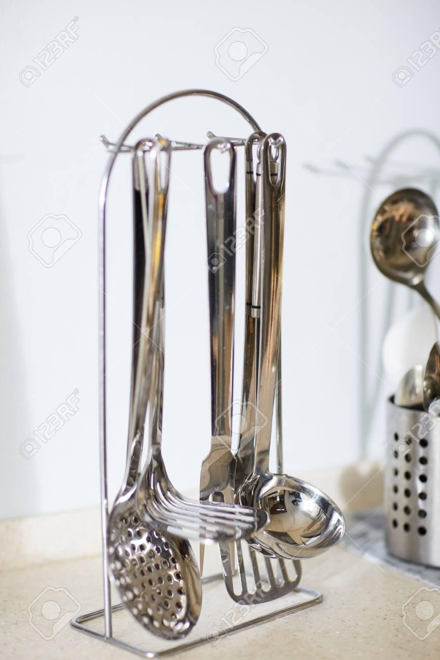 Steel cooking utensils holder