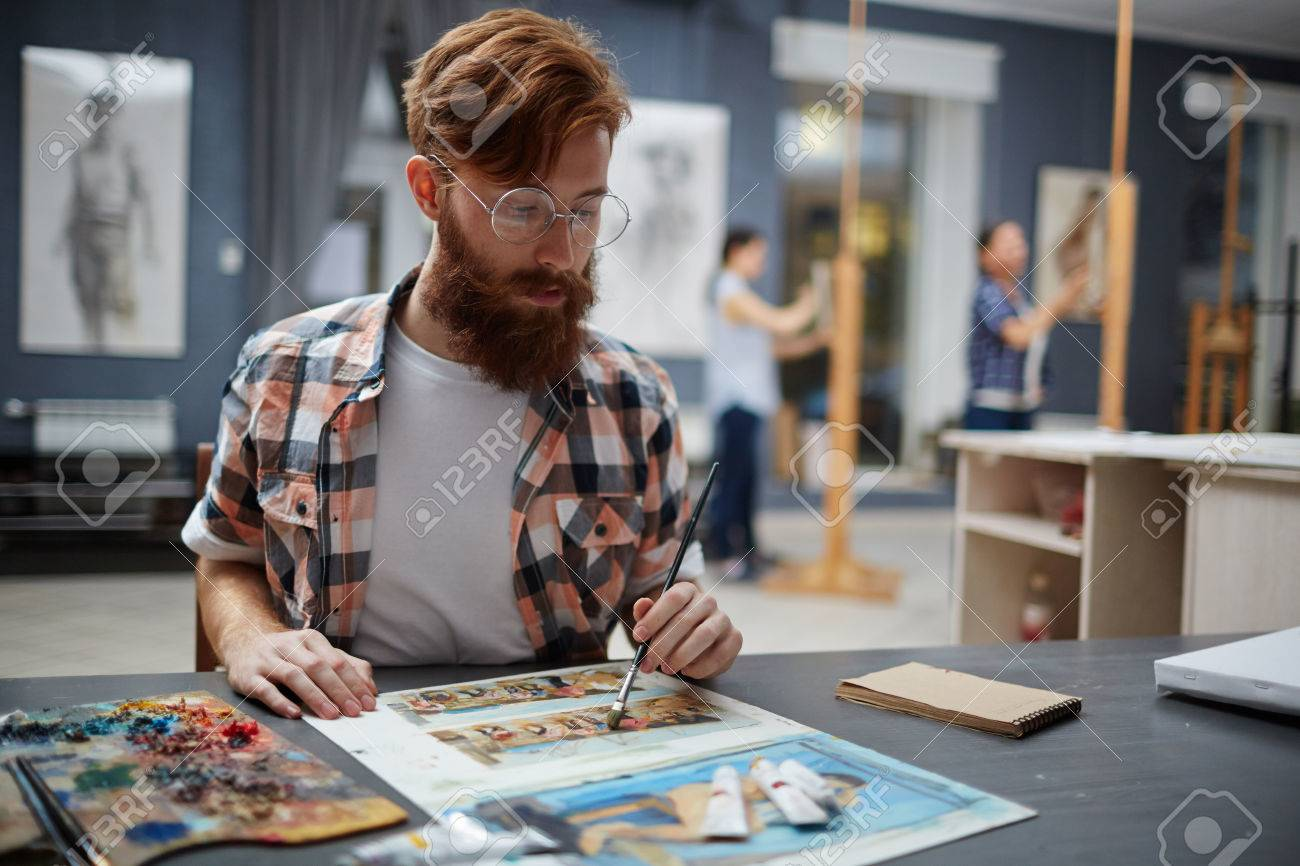 hipster artist painting pictures in art class stock photo picture