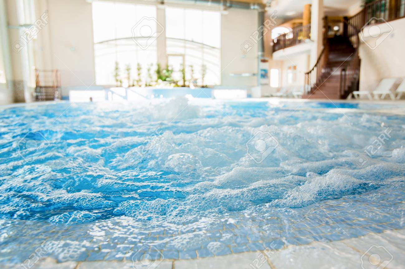 Waves and splashes in warm spa tub with nobody around - 87935932