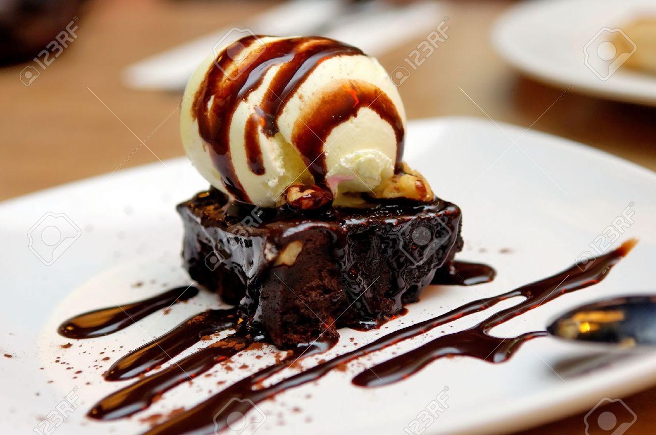 Chocolate Brownie With Vanilla Ice-cream And Chocolate Sauce Stock ...